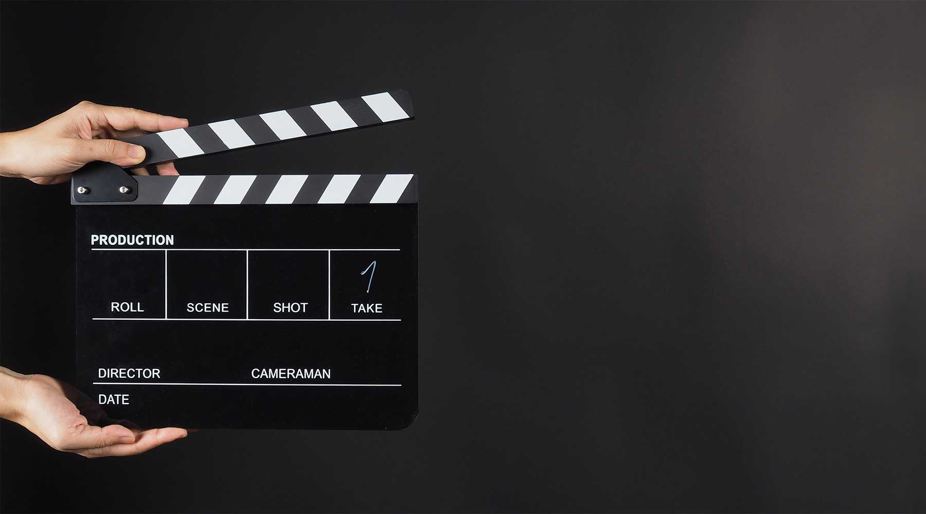 clapperboard-on-black-background-with-hands